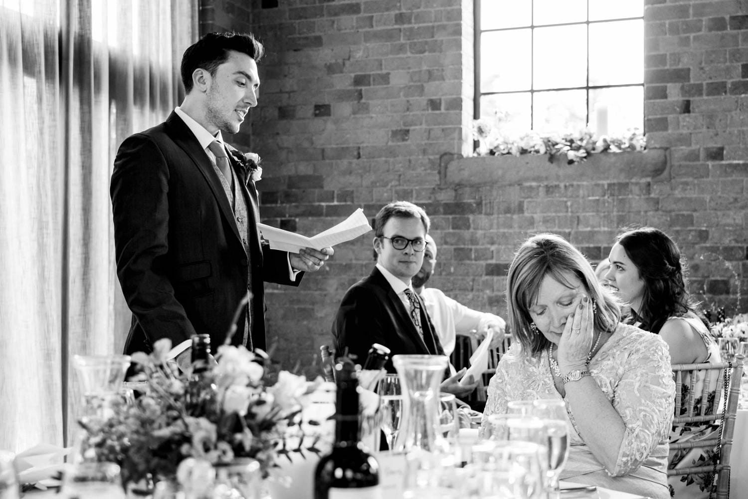 Wedding speeches from Groom at Carriage Hall whilst mother of groom wipes a tear away from her eyes