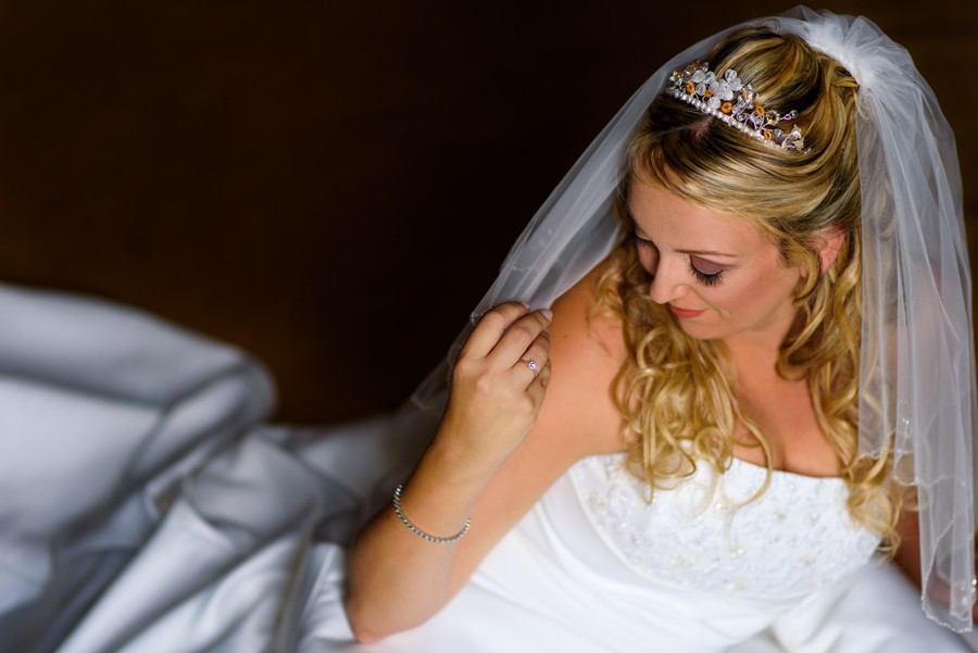 Colwick Hall wedding photograph of bride playing with veil before her wedding at