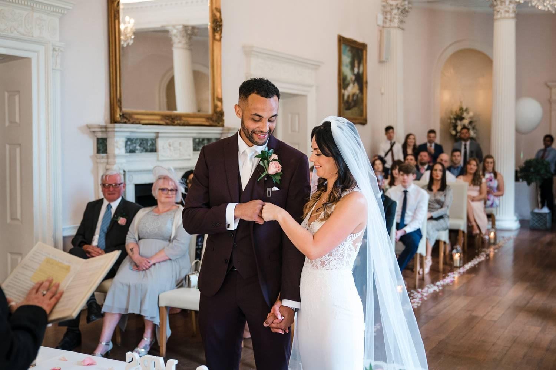 Bride & groom bump fists during wedding ceremony