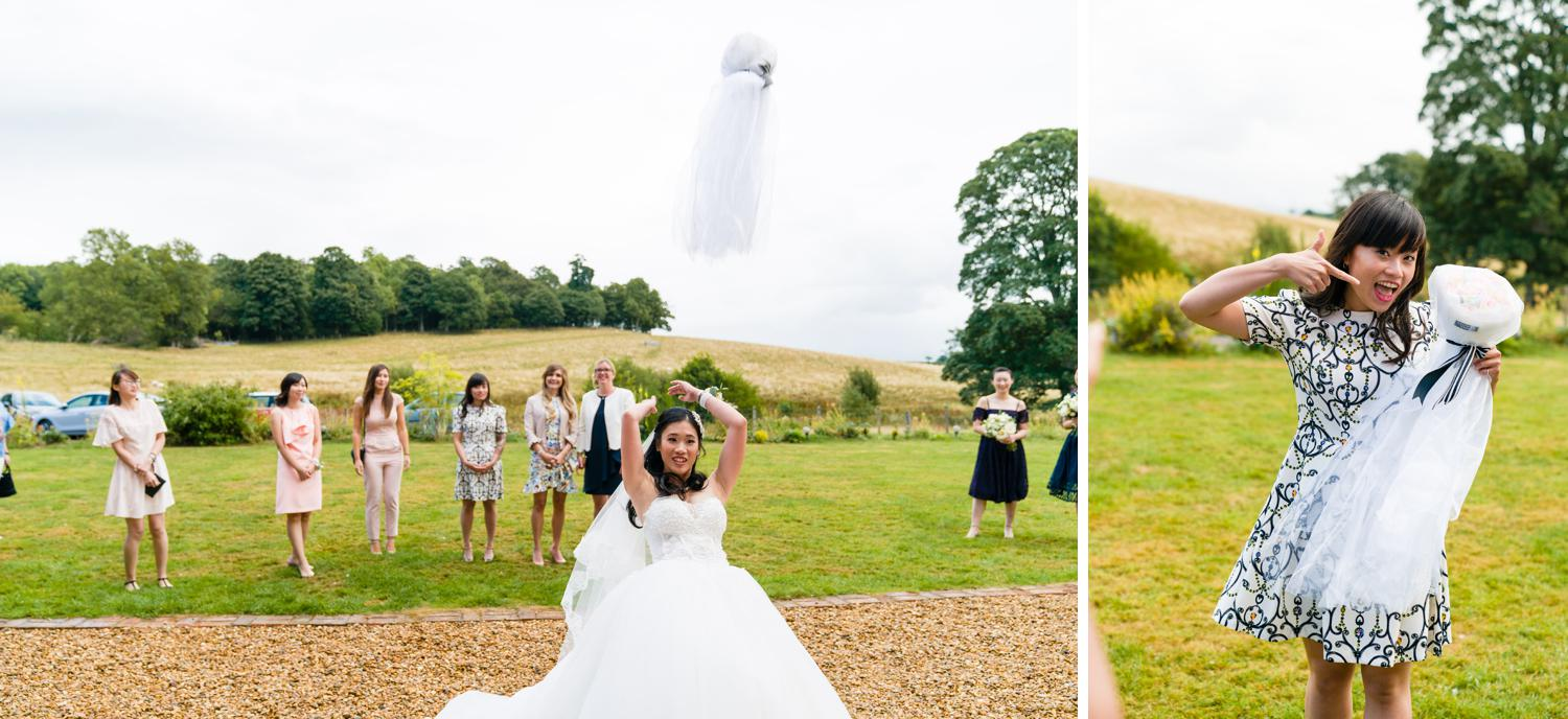 Bride throwing her bouquet at Eriviat Hall in Wales