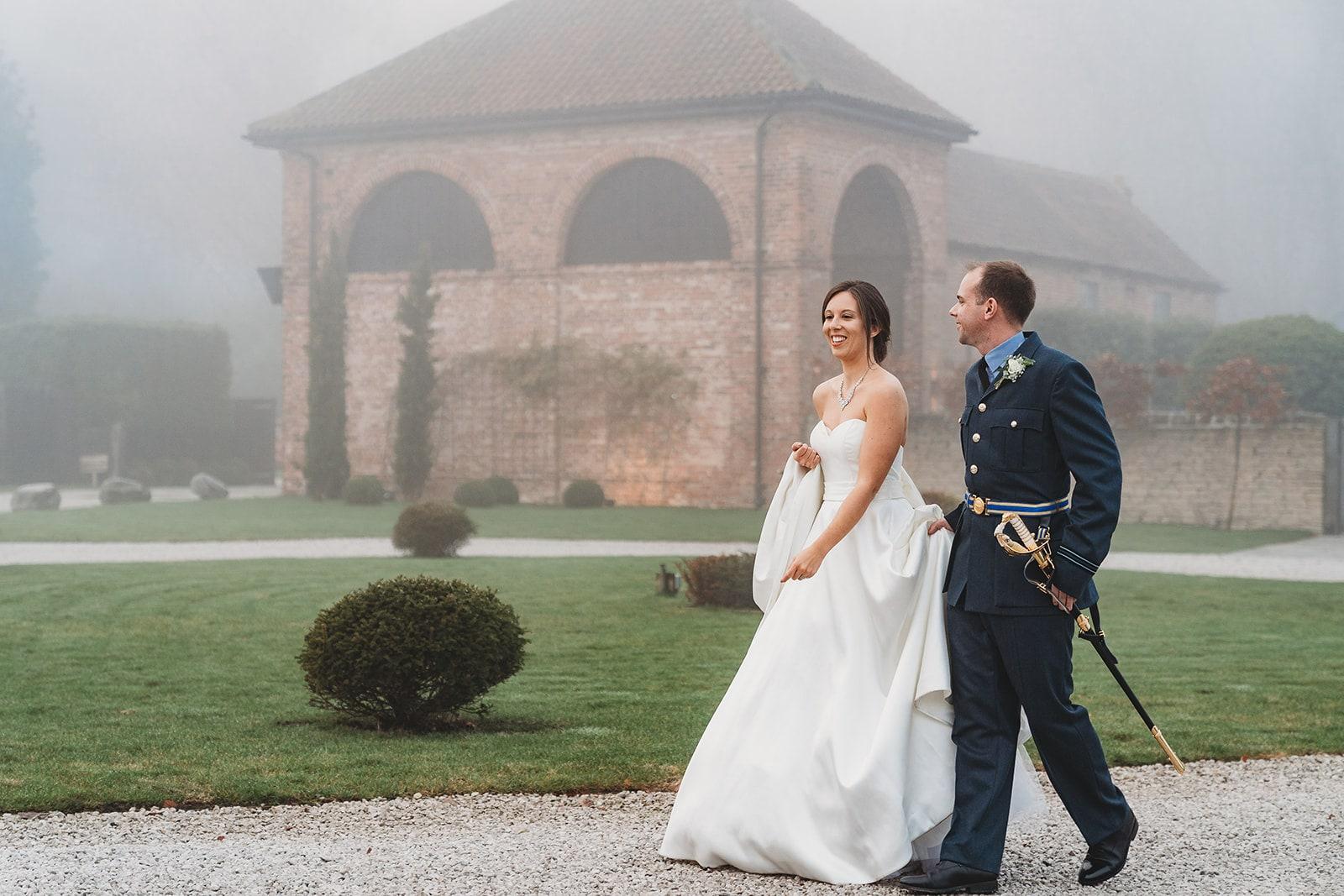 Bride and groom take a short walk around Hazel Gap Barn