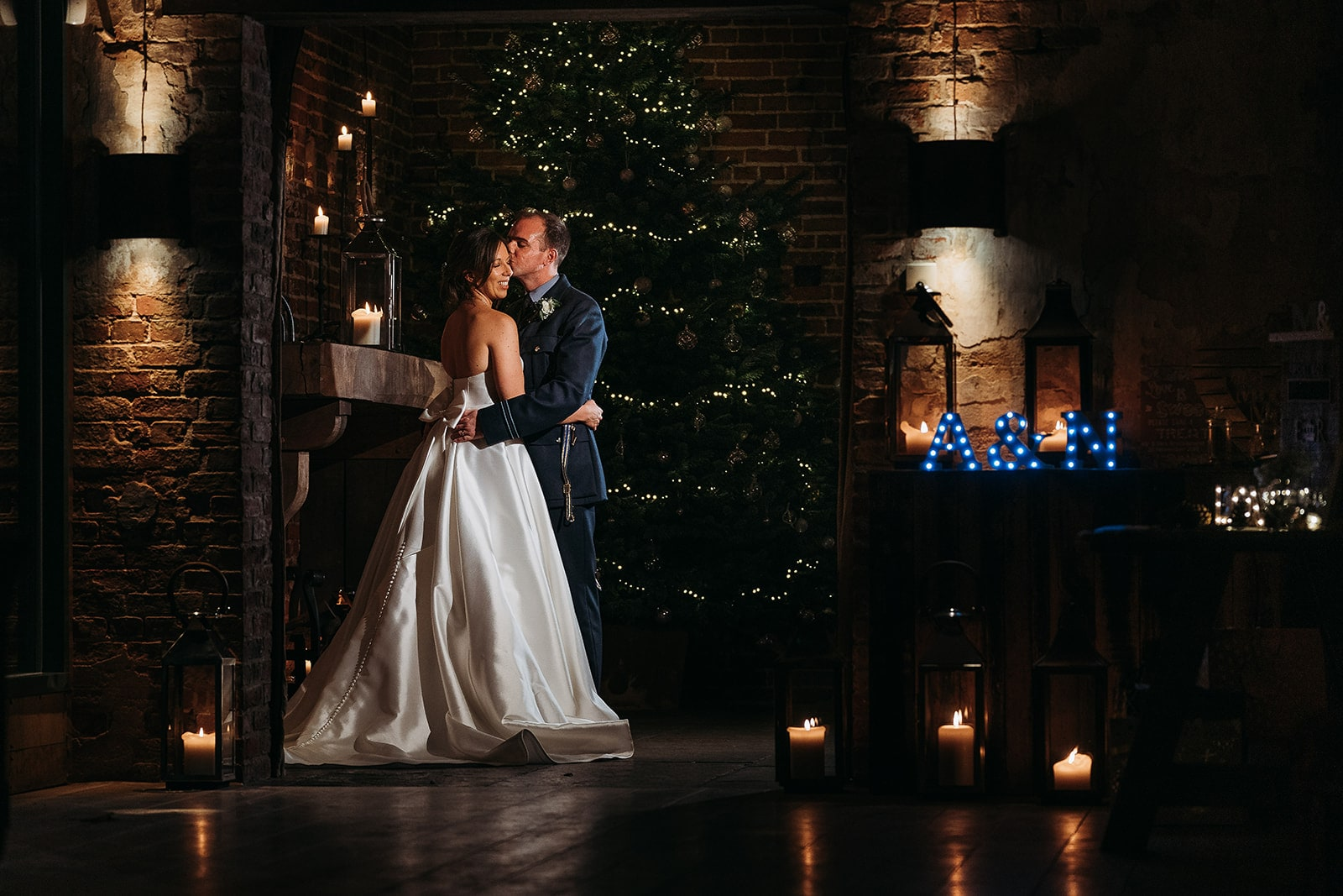 Christmas wedding photograph at Hazel Gap Barn with Christmas tree in background