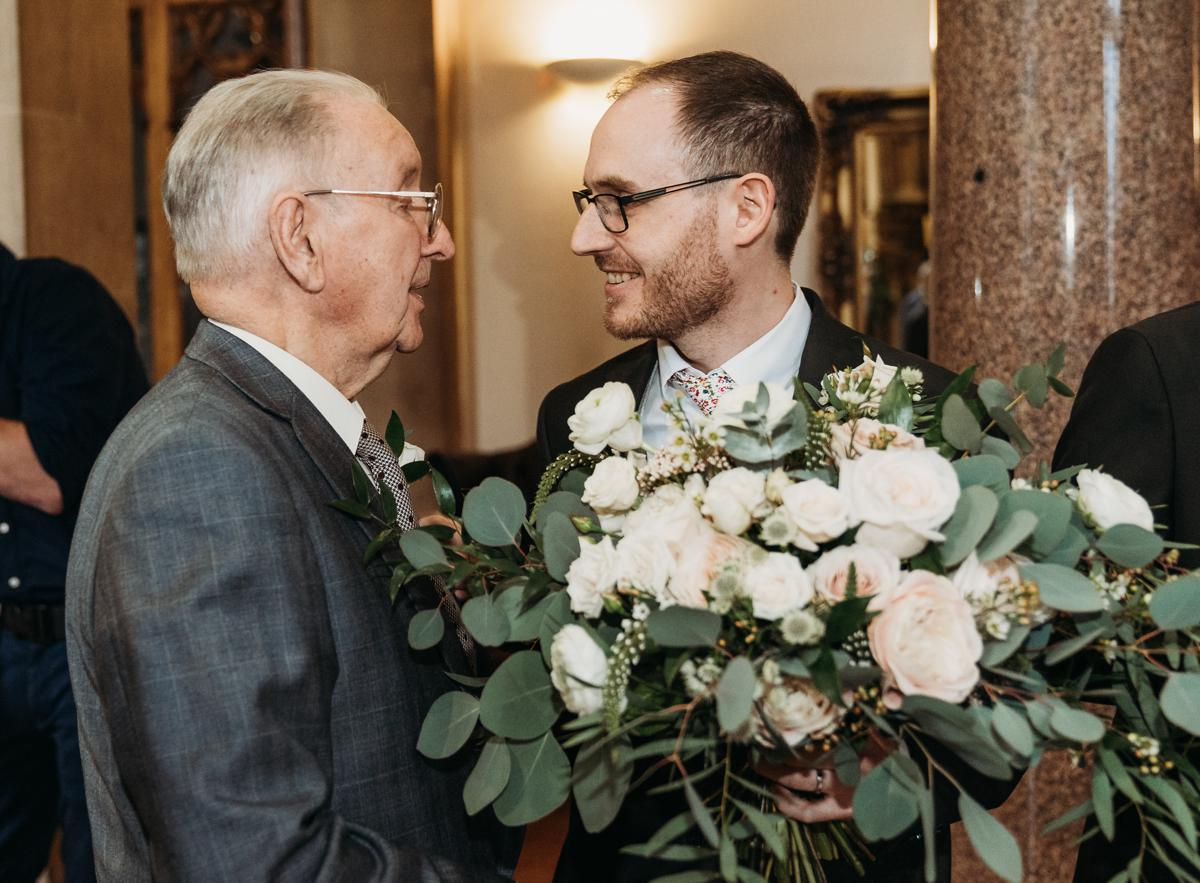 Groom talking to his grandad just after his wedding ceremony at Kelham Hall