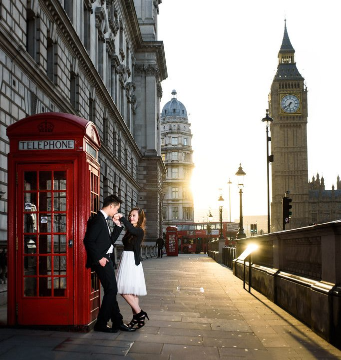 Bride & groom outside a red telephone box near Westminster, London
