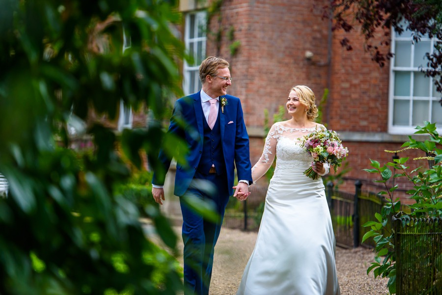 Bride & groom walking. Photo taken by a Norwood Park Wedding Photographer