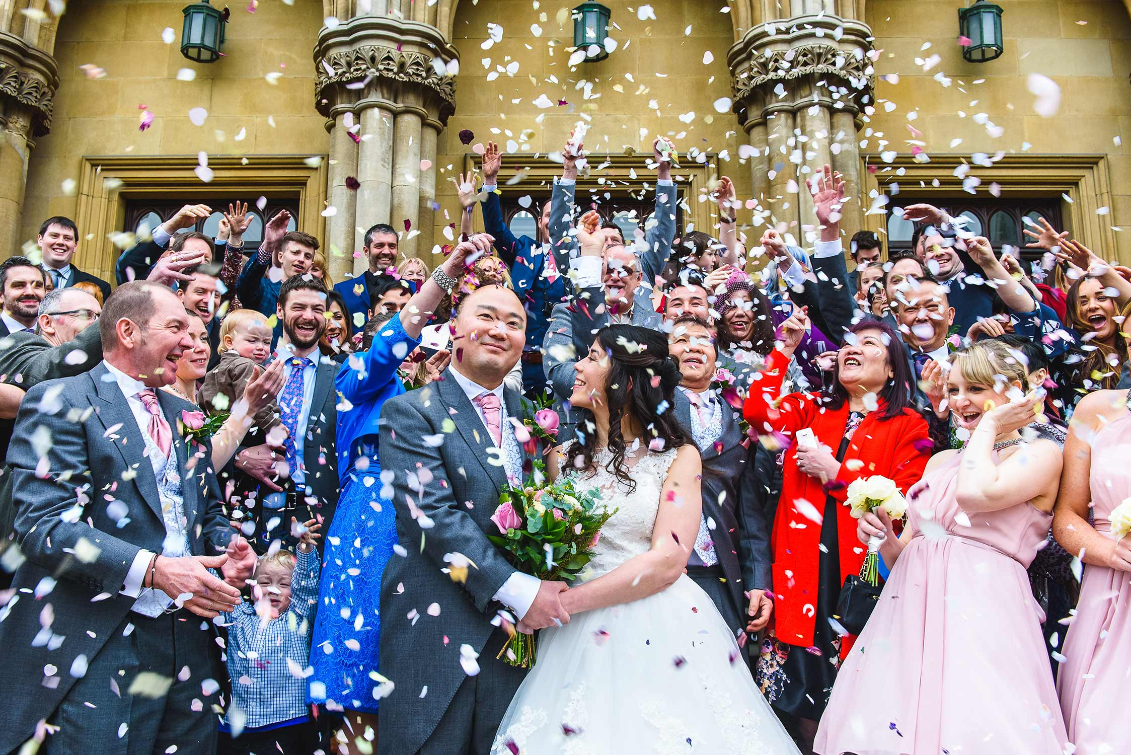 Wedding confetti covering bride & groom in Nottingham