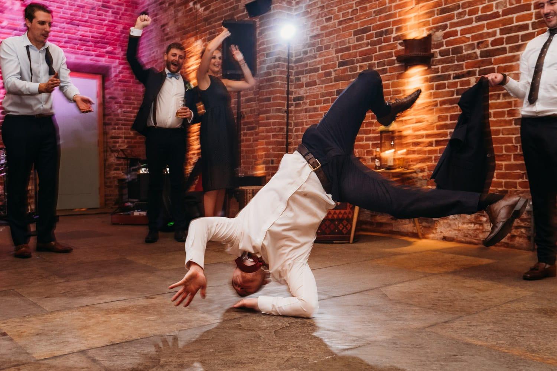 Wedding guest breakdancing during party at Hazel Gap Barn