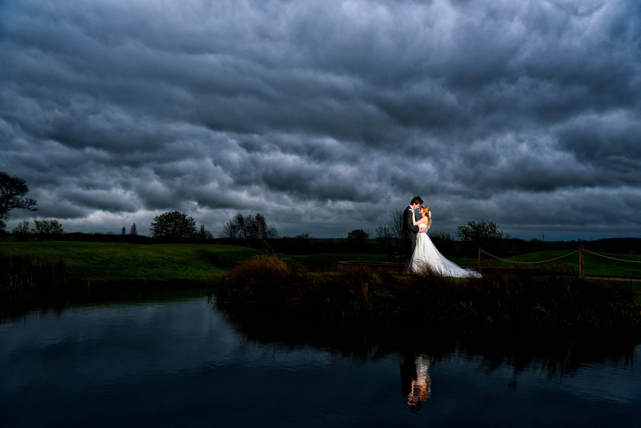 Bride & Groom at a rainy wedding at The Nottinghamshire