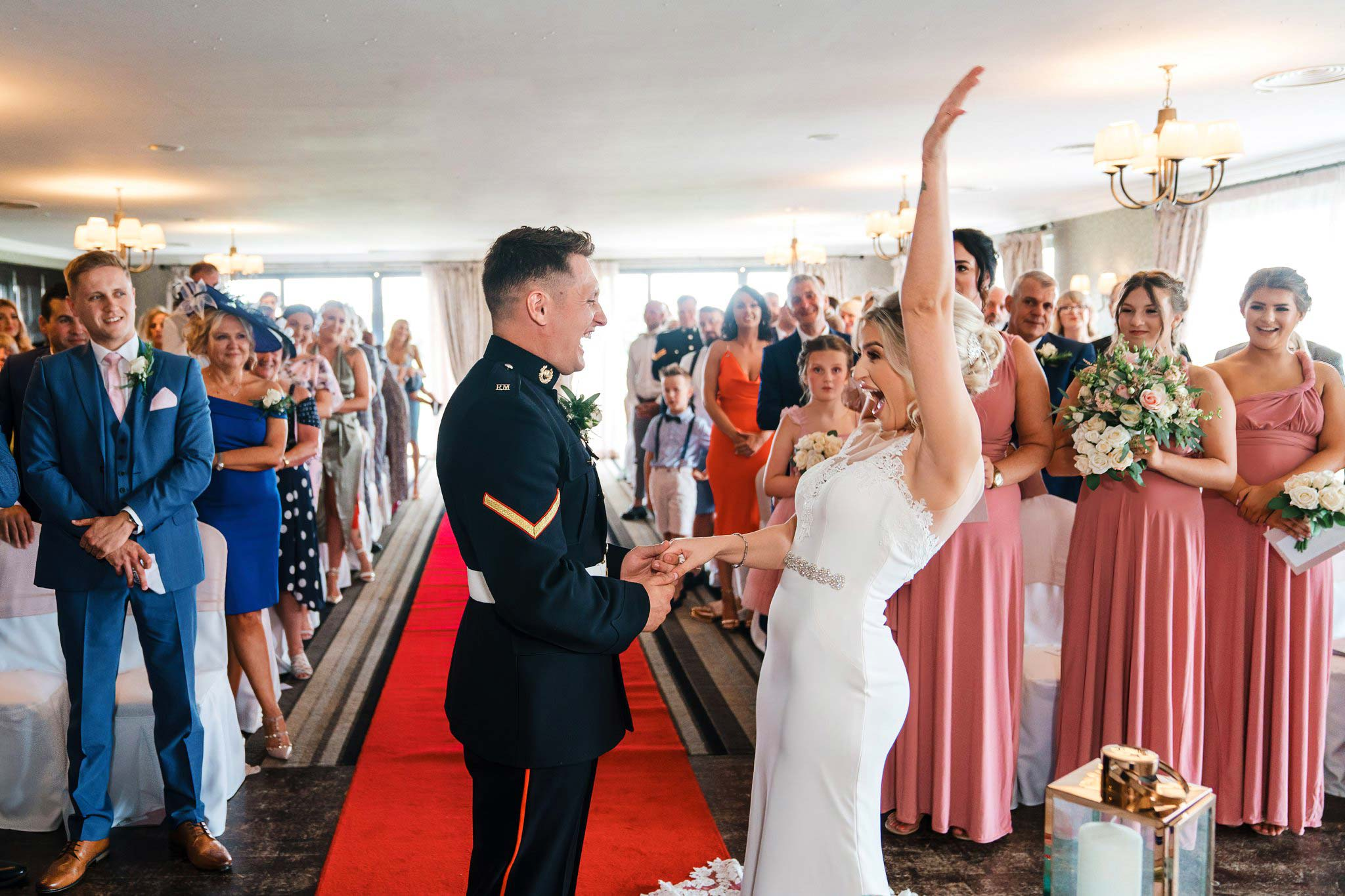 Bride cheers after getting married at the Nottinghamshire