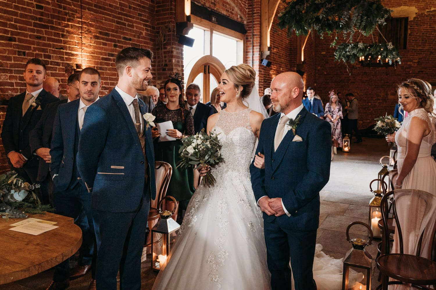 Bride has big smile on face as she meets her waiting groom at Hazel Gap Barn