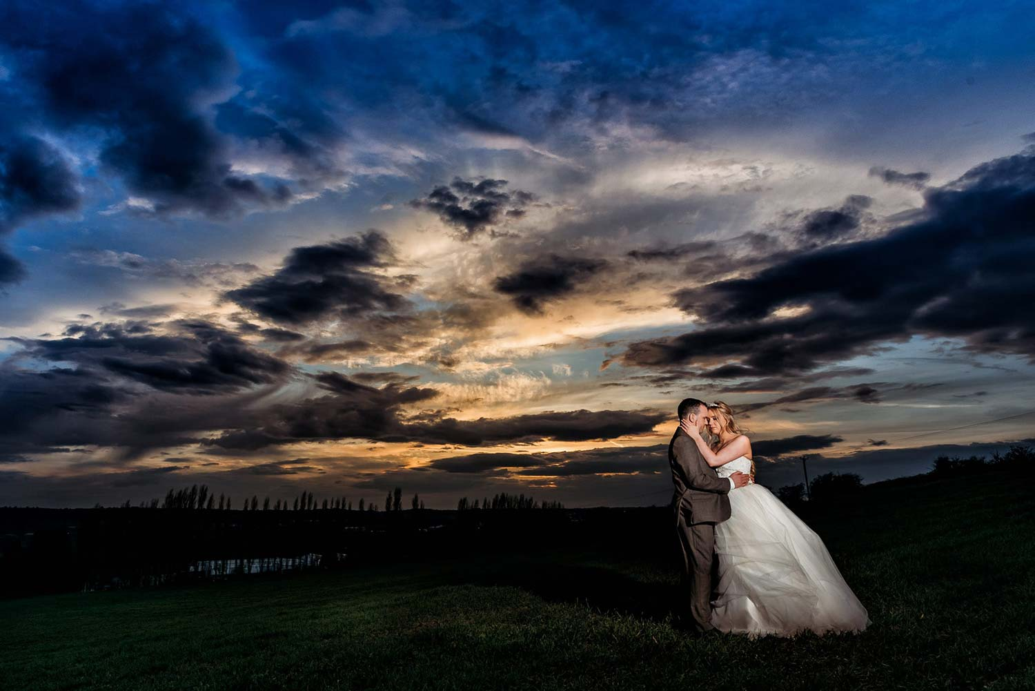 Sunset Wedding Photo at Swancar Farm taken in the field behind this stunning venue