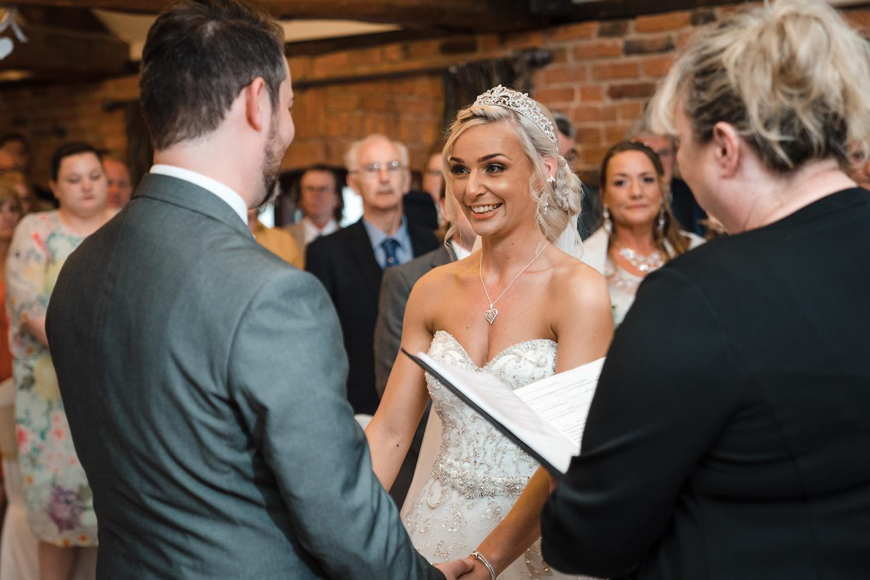 Bride & groom exchange vows at Swancar Farm