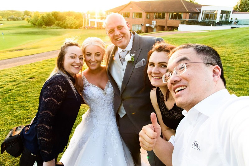 Taking a selfie with the bride & groom