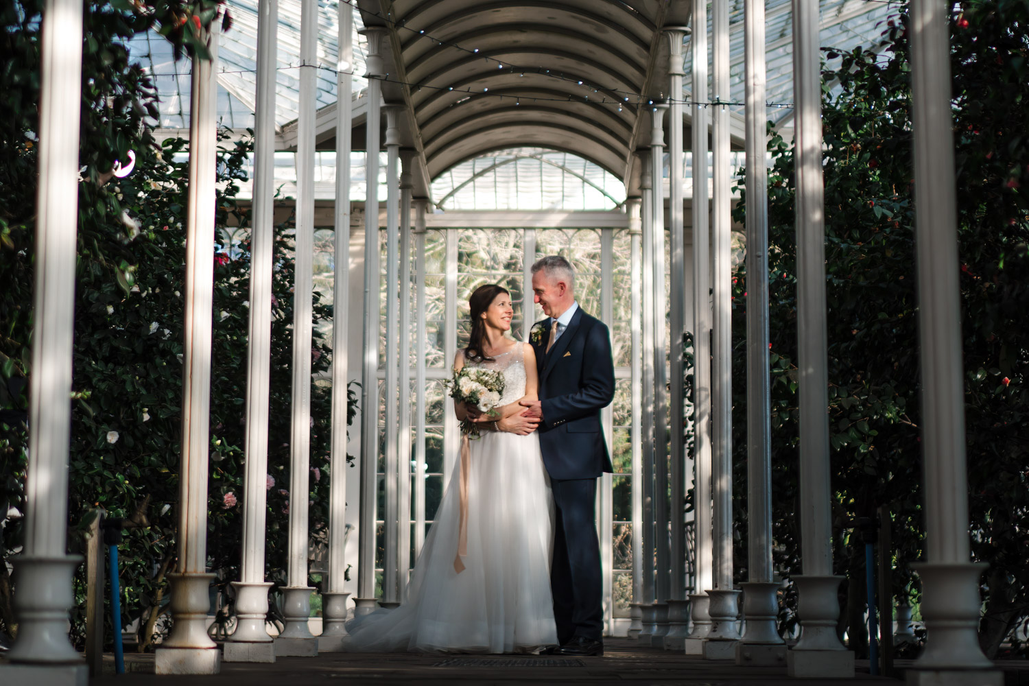Bride and grooom in Camellia House, Wollaton Hall