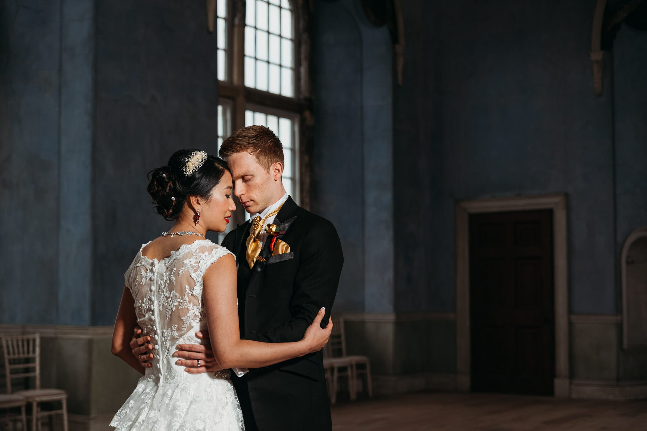 Wedding photo of bride & groom in prospect room at Wollaton Hall in Nottingham