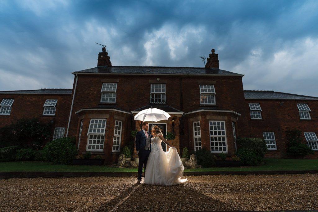 Rainy wedding day photo outside Swancar Farm