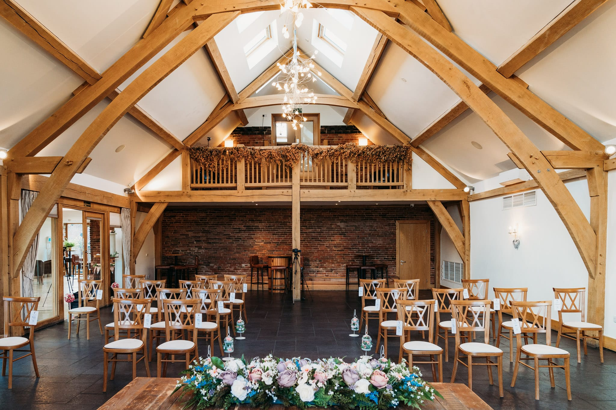 The Oak Room at Mythe Barn set up for a wedding ceremony