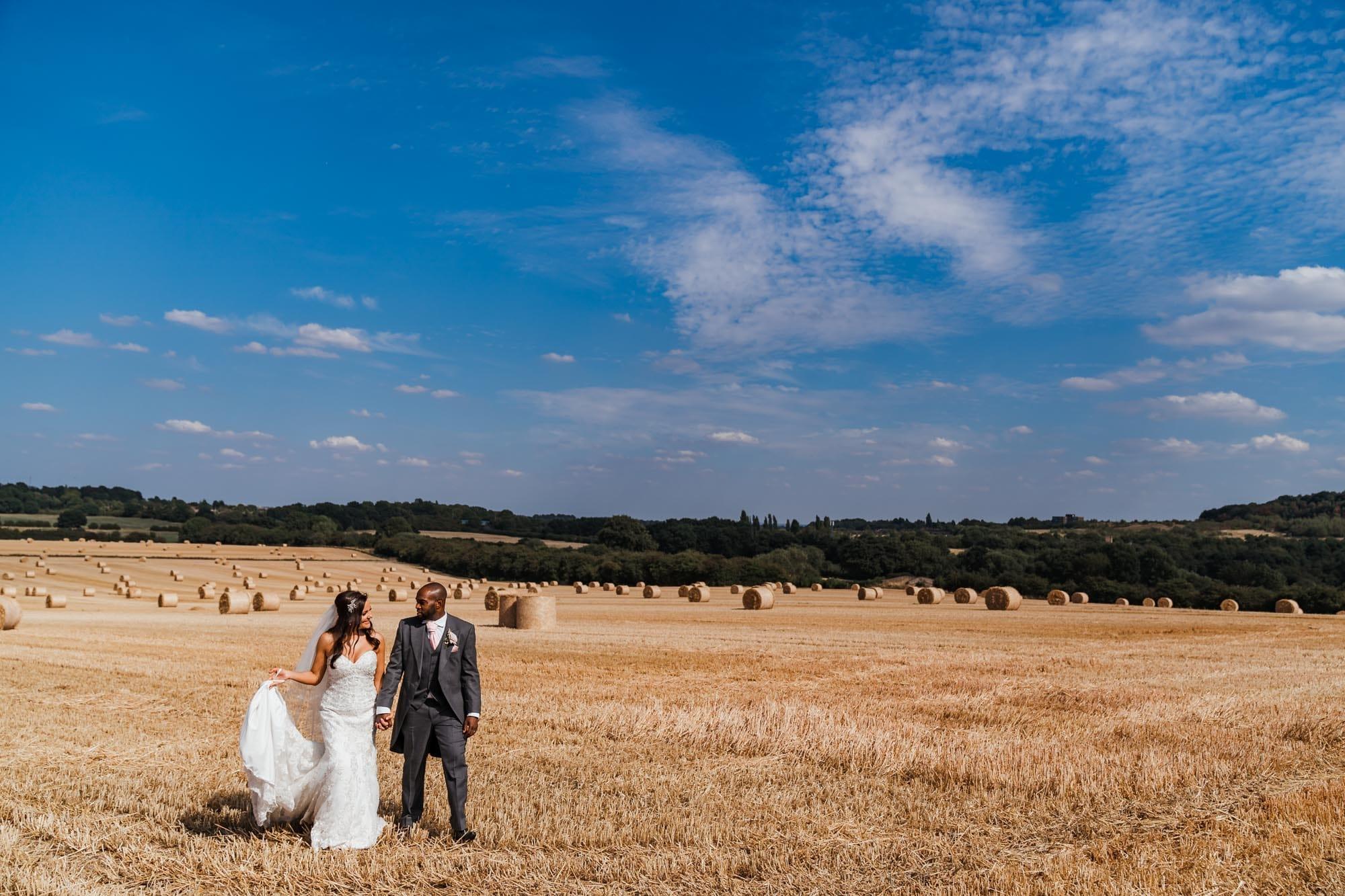 bride & groom walking at Swancar Farm