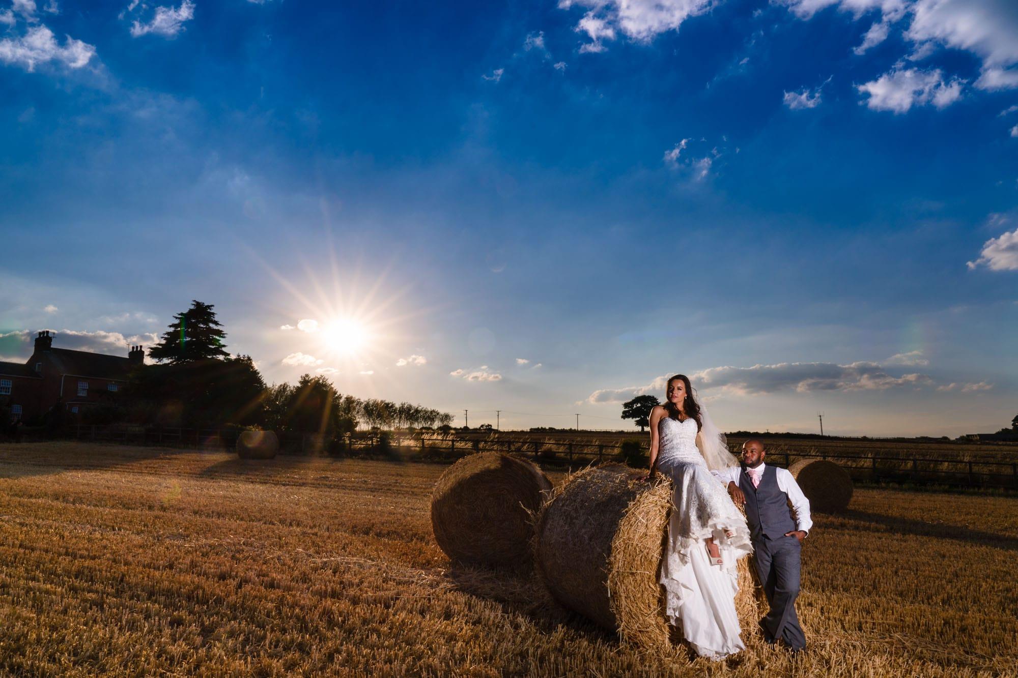 bride & groom strike a pose at Swancar Farm