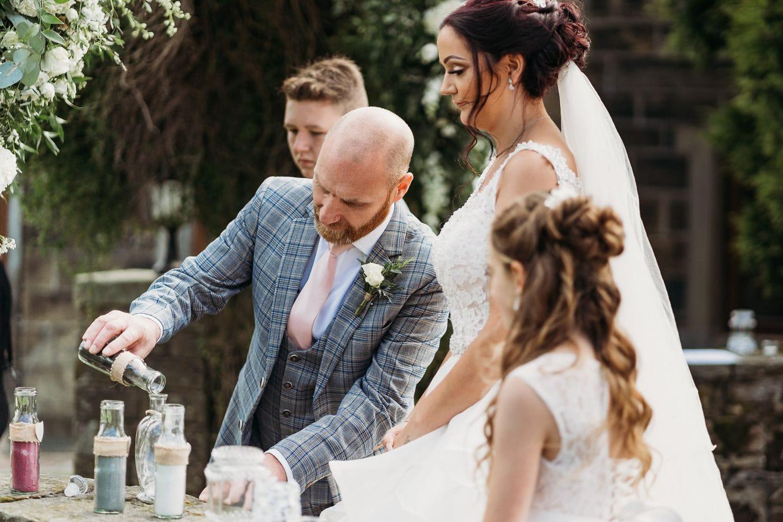Sand ceremony at a humanist celebrant led wedding